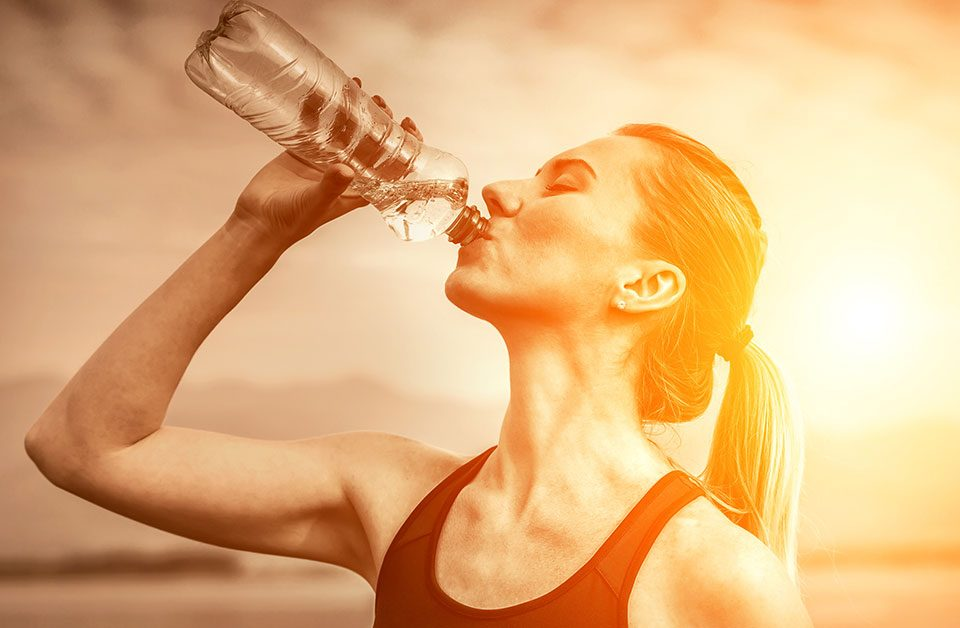 woman-drinking-water-on-hot-sunny-day